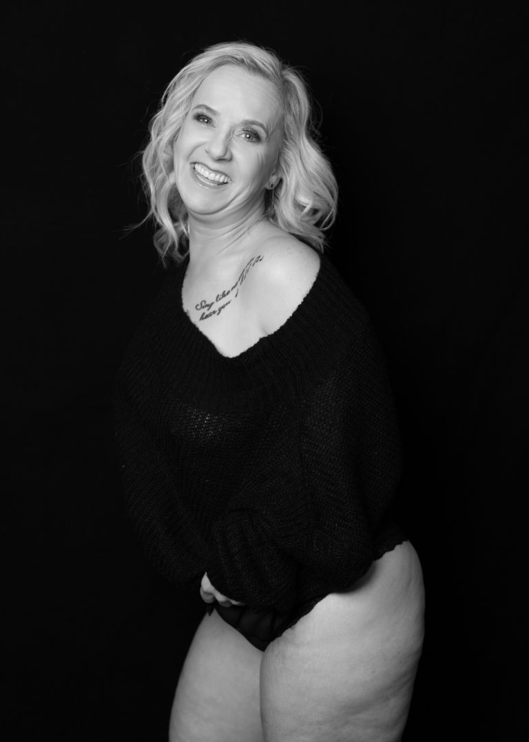 black and white blonde with big smile